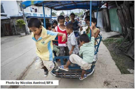 Children going to school via somlot, a motorcycle rickshaw in Mae Sot, Thailand