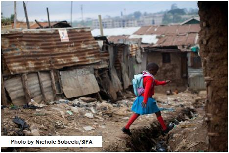 Six-year-old Elizabeth Atenio walks two hours every day to attend classes at the Kibera School for Girls in Nairobi.
